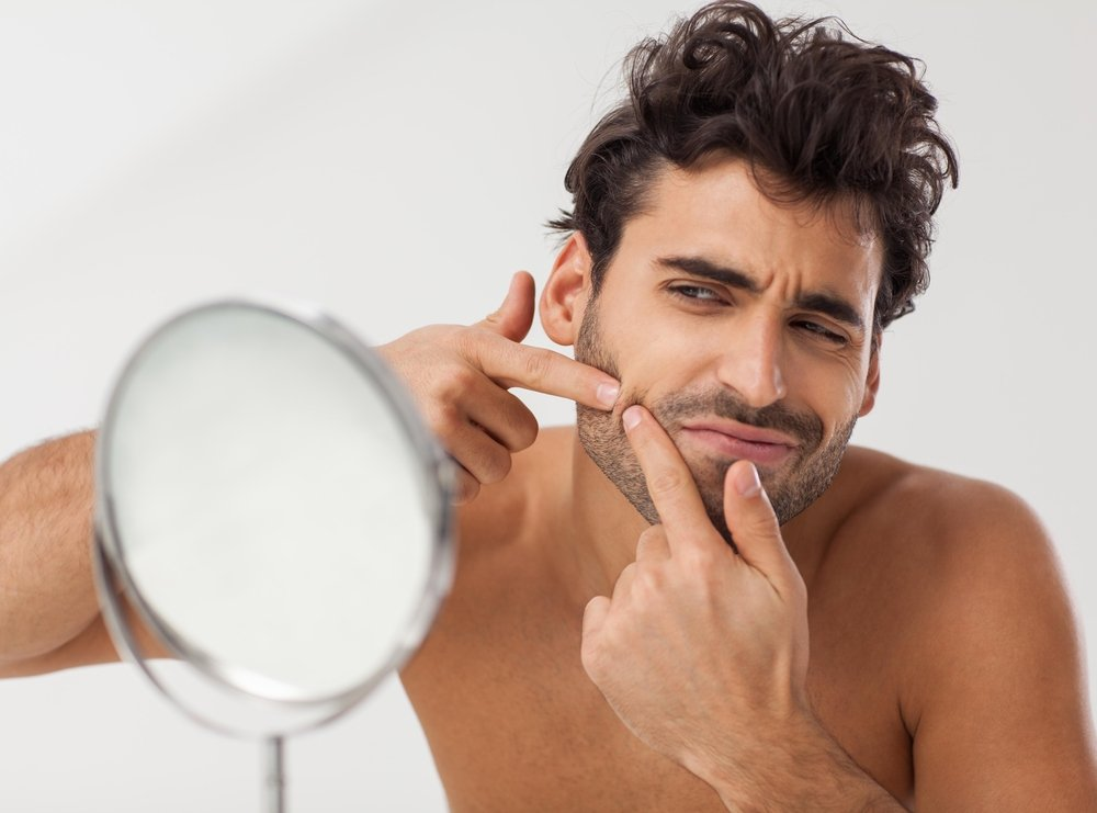 male model trying to pop a pimple