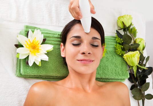 Young Woman Getting A Face Treatment In A Beauty Spa