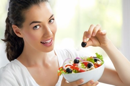 model holding a salad
