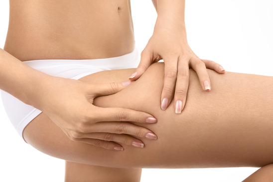 Female hands pinch on a hip a skin, isolated