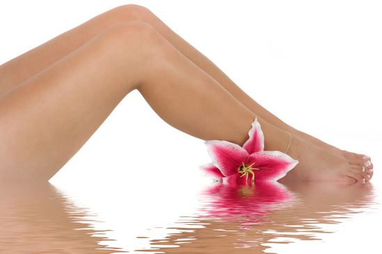 Beautiful legs with a pink lily flower