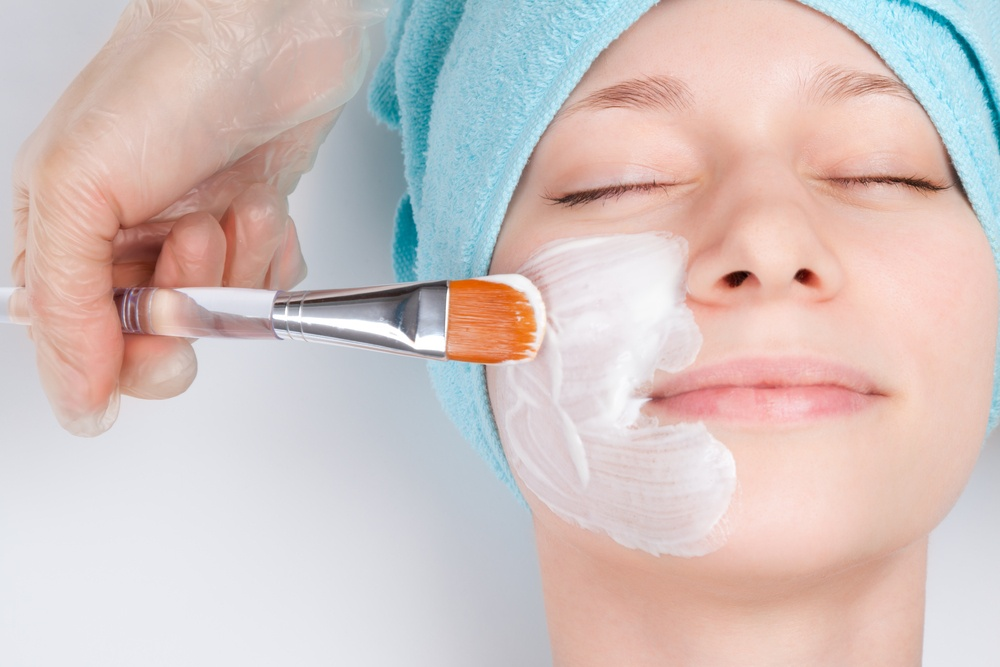girl getting a face mask