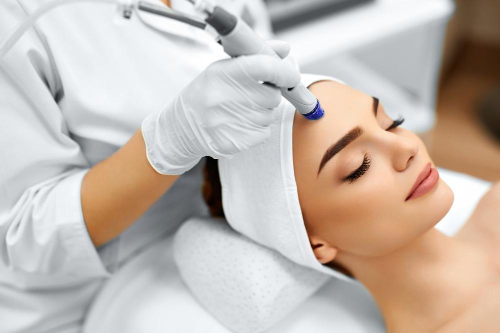 model getting a facial treatment