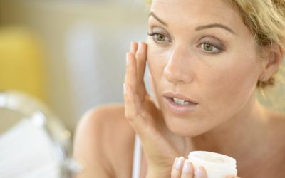 Woman putting on a skin cream