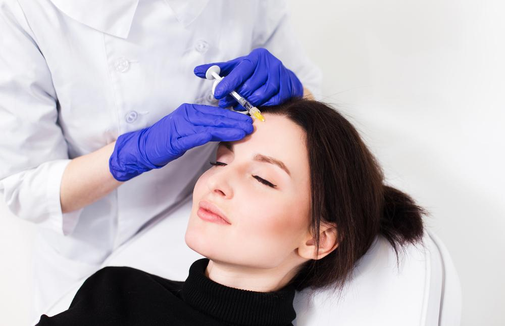 woman getting a wart treatment