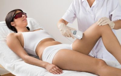 doctor performing laser hair removal on a female patient