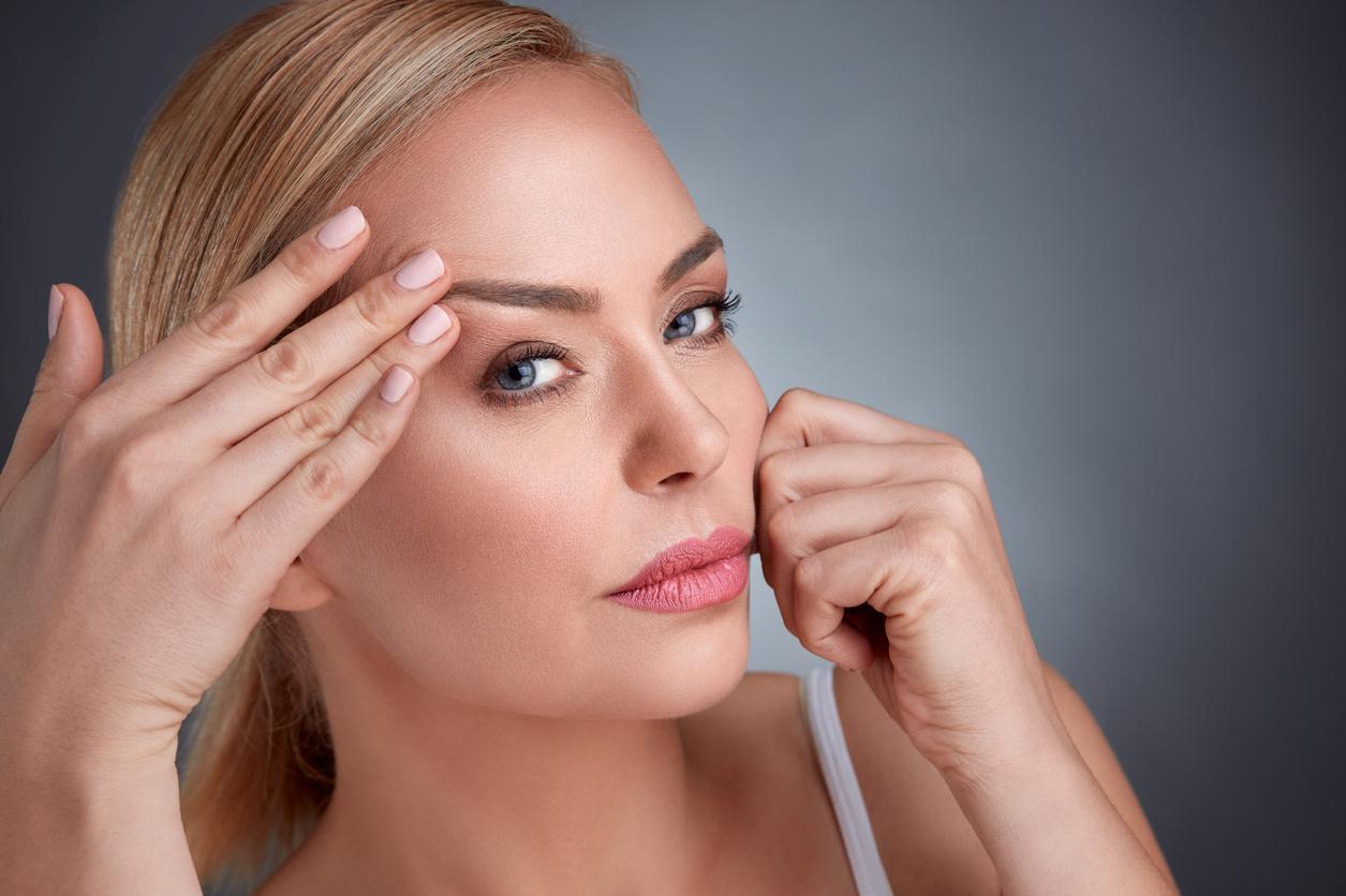 Blonde model showing off her wrinkle free skin