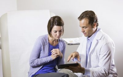 male doctor with female patient in a consultation