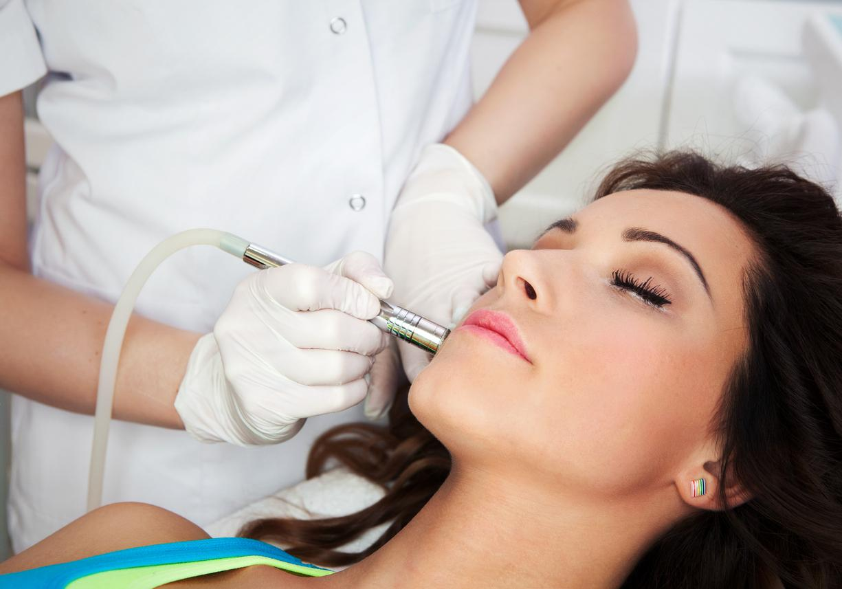 Patient getting Laser Acne Removal Treatment