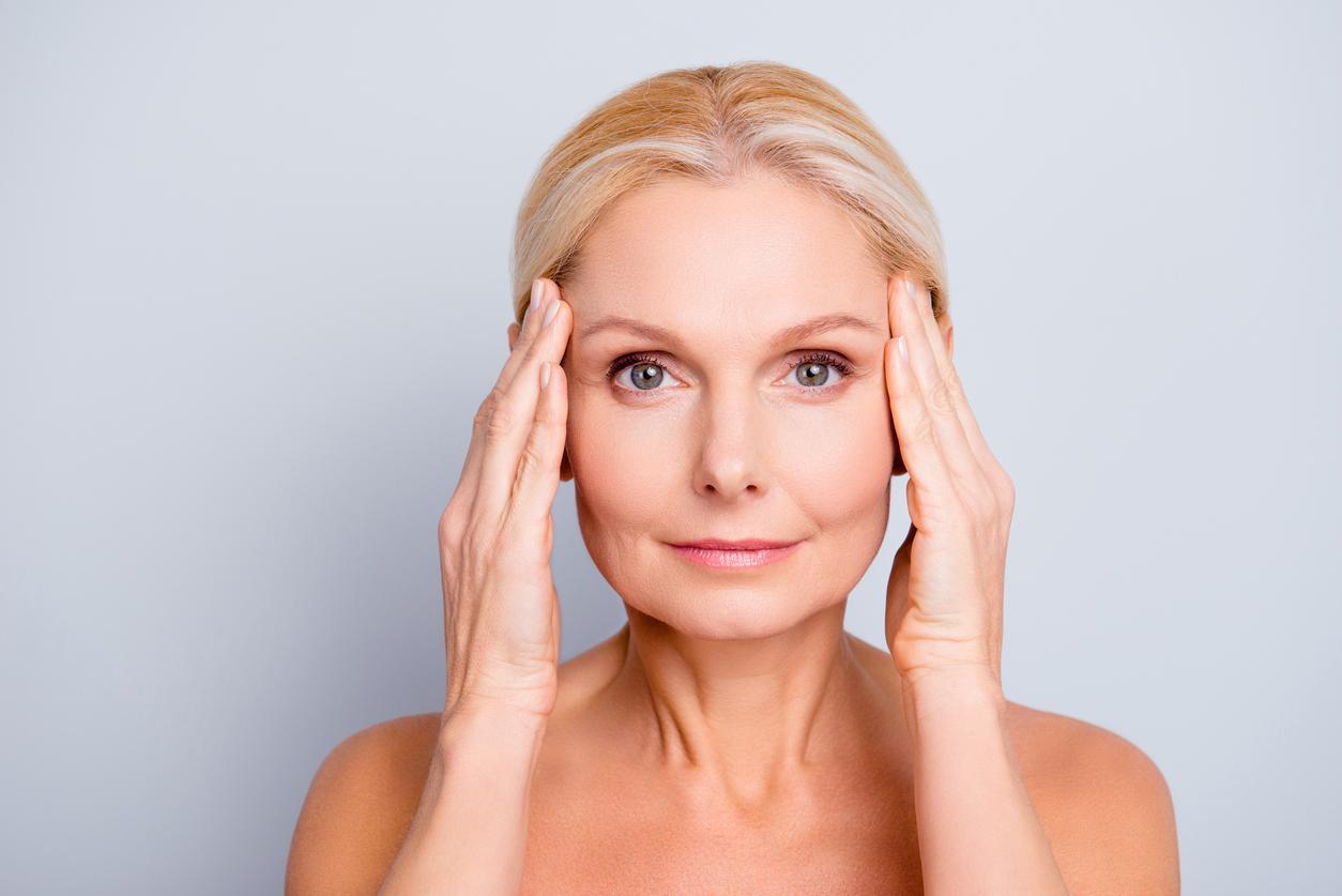 headshot of older woman showing her skin