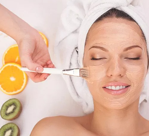 model getting a citrus brightening facial