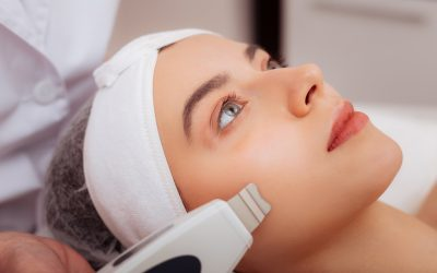 Beautiful attractive woman having a facial procedure while visiting a beauty clinic