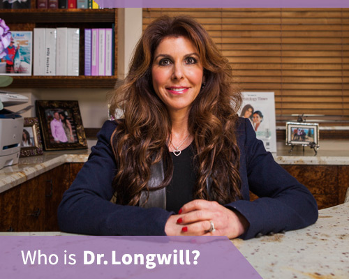 Dr longwill sitting at her desk