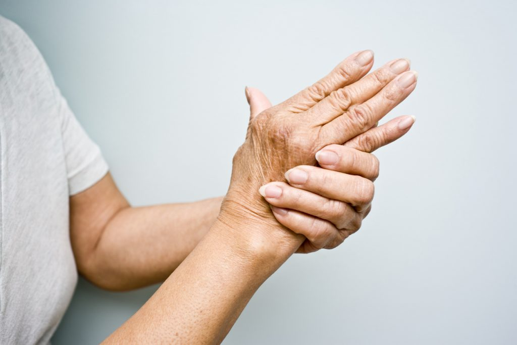 Elderly woman holding her hands