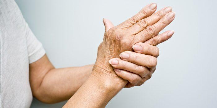 Elderly woman holding her hands