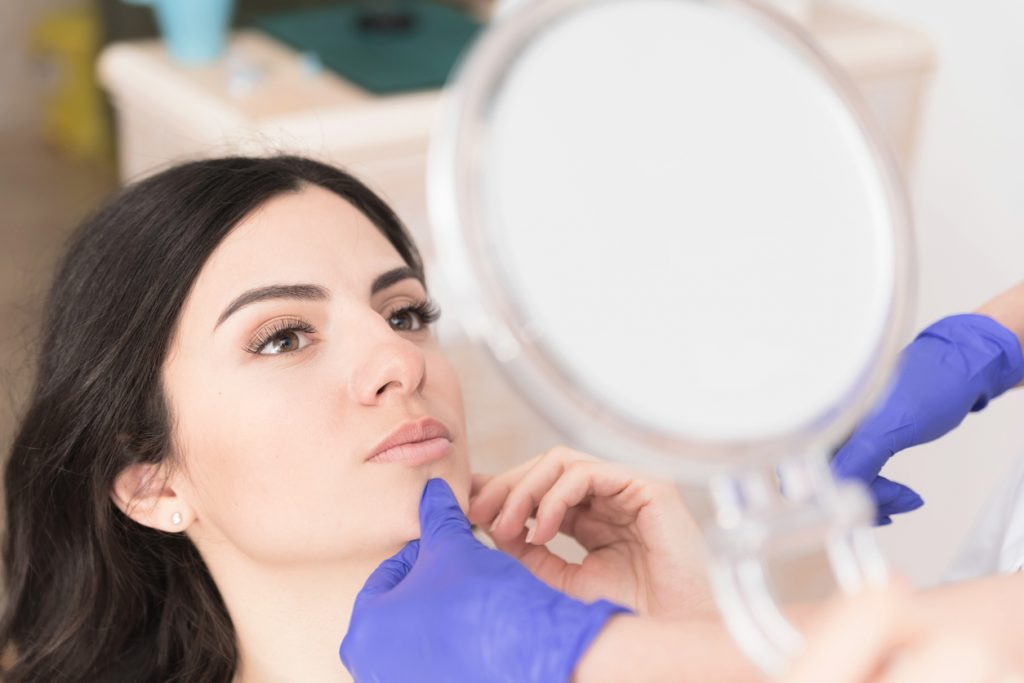 Woman having corrective aesthetic procedure