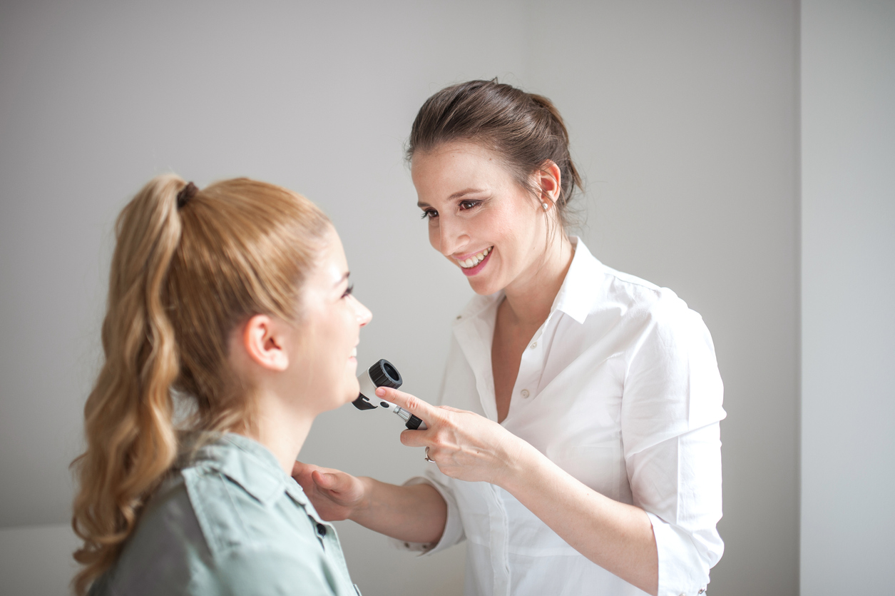 Dermatologist Inspecting Patient Face Skin with Dermatoscope