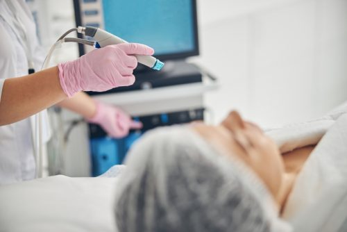 Woman about to get a hydrodermabrasion procedure at a medspa.